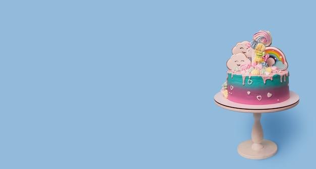 Banner met mooi feestelijk met eenhoorn kindertaart op een standaard op een blauw