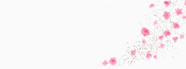 Banner. roze bloemen, glitter confetti splash op wit