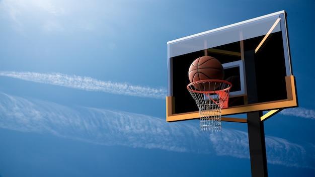 Basketbal die hoepel op mooie blauwe hemelachtergrond ingaan