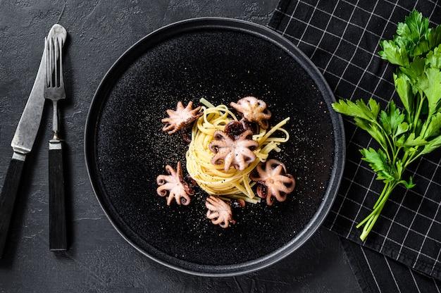 Bavette pasta met baby octopus.