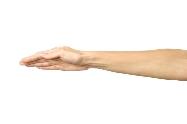 Bedekking en bescherming. vrouw hand met franse manicure gebaren geïsoleerd op een witte achtergrond. onderdeel van series