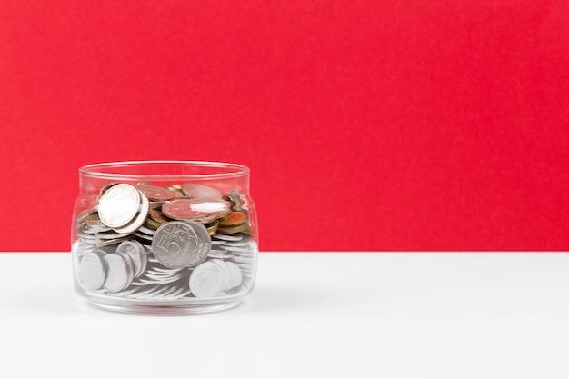 Bedrijfsconcept, planning opslaan met munten in glazen pot