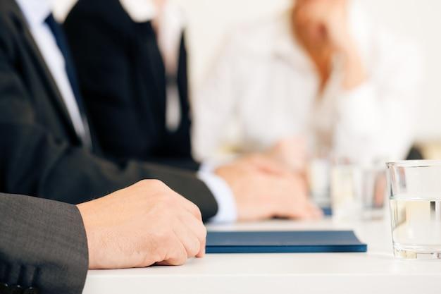 Bedrijfssituatie, team in vergadering