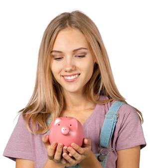 Beeld van mooie vrouw met spaarvarken