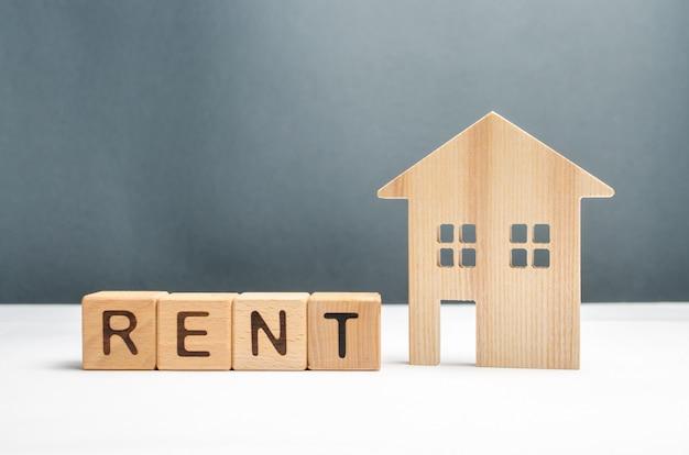 Beeldje huizen en kubussen met het woord huur