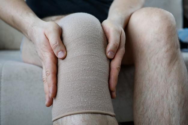 Behandeling van pijn en kraakbeenslijtageconcept