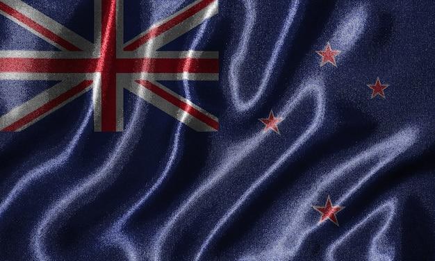 Behang van de vlag van nieuw-zeeland en zwaaiende vlag met stof.