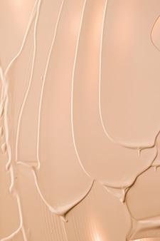 Beige cosmetische textuur achtergrond make-up en huidverzorging cosmetica product crème lippenstift foundation ma...