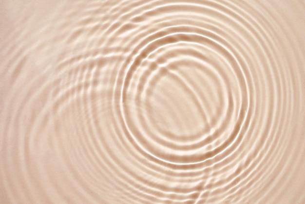 Beige crème textuur met cirkels en rimpelingen abstracte cosmetica achtergrond