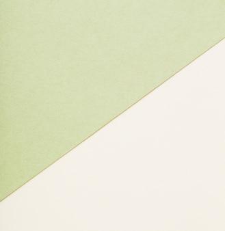 Beige en groene vellen papier