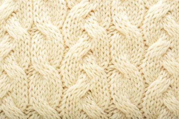 Beige gebreide stof wol textuur achtergrond