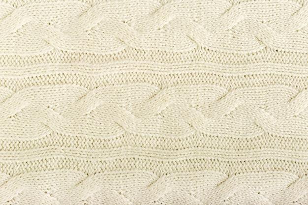 Beige gebreide stof wol textuur voor achtergrond.