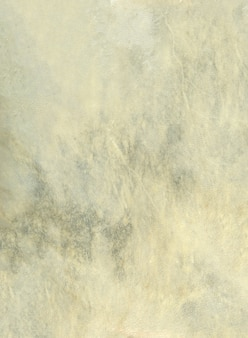 Beige lederen drum huid achtergrondstructuur. close-up uitzicht