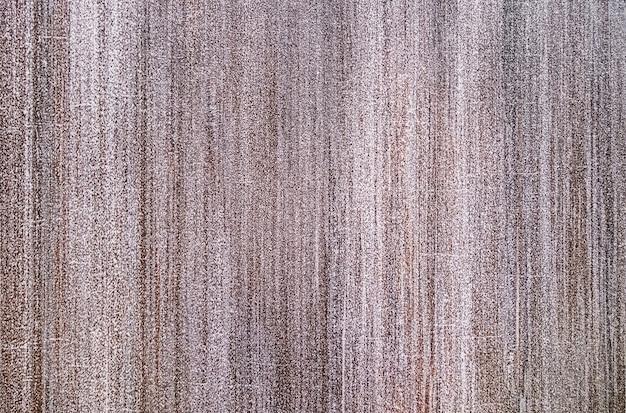 Beige marmeren gevelachtergrond met verdwijnende verticale lijnen.