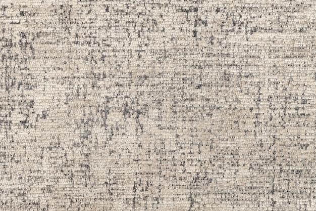 Beige pluizige achtergrond van zachte, wollige doek. textuur van textielclose-up