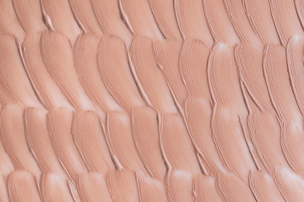 Beige uitstrijkje van foundation textuur. cosmetica concept.