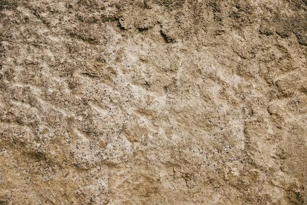 Beige van de granietrots textuur als achtergrond