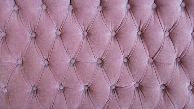 Bekleding van modieuze roze bank close-up
