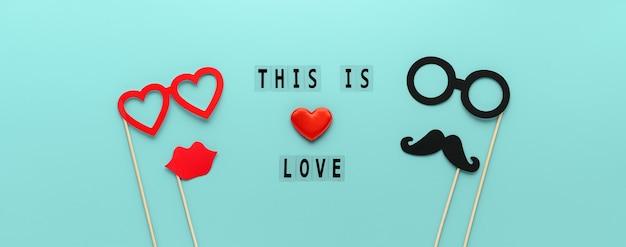 Belettering this is love en papieren rekwisieten snor, lippen en bril op pastel