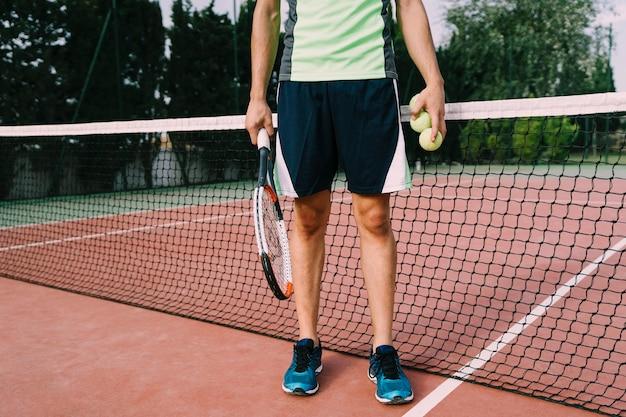 Benen van tennisspeler