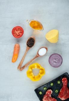 Bereiding voor kip met olie, kruiden en groenten