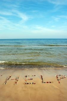 Bericht in het zand