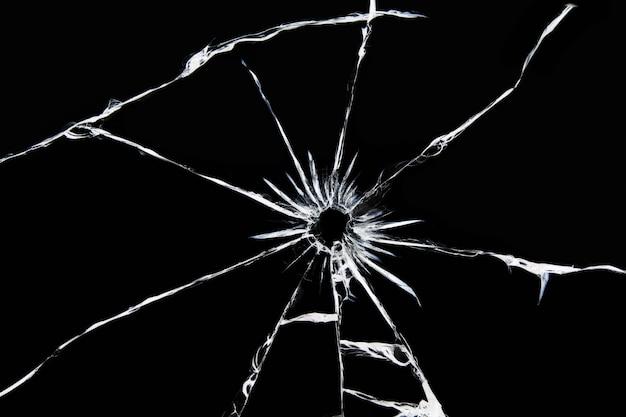 Beschadigd glas met barsten, barsten in het glas van de opname