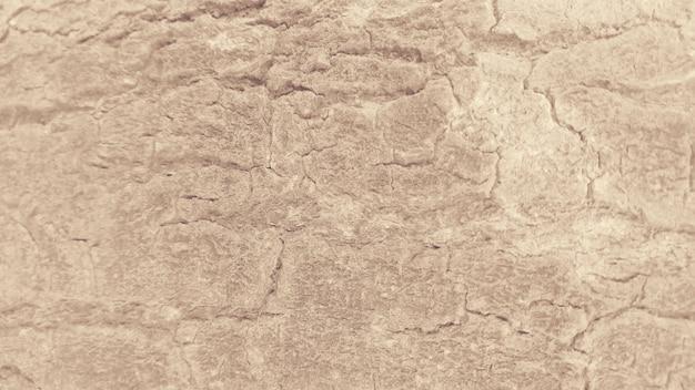 Beschadigde oppervlaktetextuur lichtbruine achtergrond