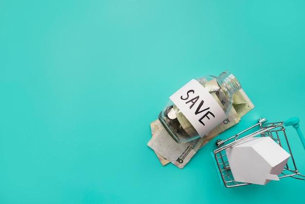 Besparingenpot met miniboodschappenwagentje