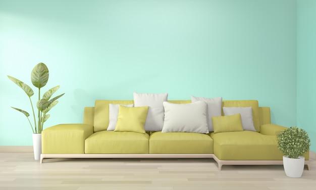 Bespotten posterframe in woonkamer met gele bank en decoratieinstallaties op vloer