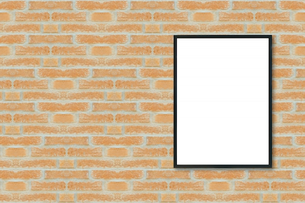 Bespotten van lege poster afbeeldingsframe op bakstenen muur.