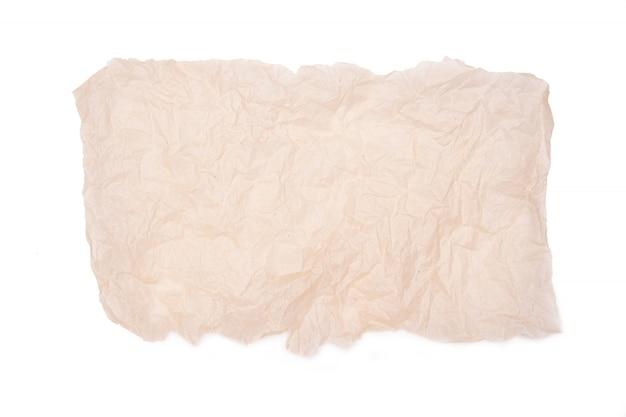 Bespotten verfrommeld vel papier op wit wordt geïsoleerd
