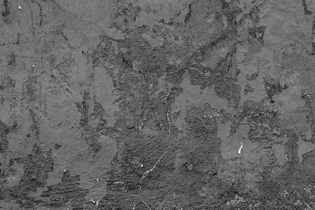 Betonnen muur met scheuren en krassen