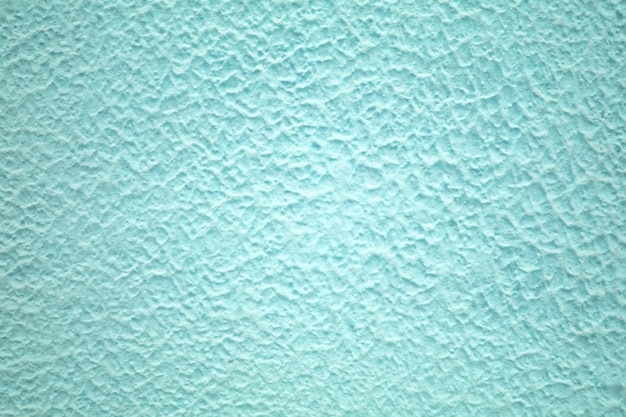 Betonnen muur van lichtblauwe kleur