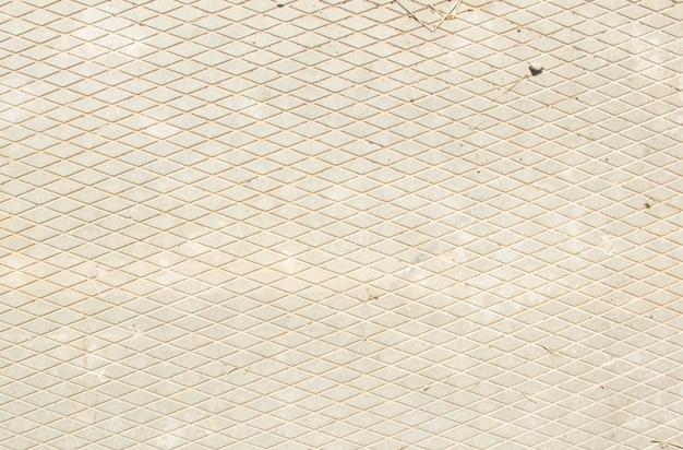 Betonnen plaat. tekening van diamanten. de textuur van de betonnen plaat. grijze achtergrond.