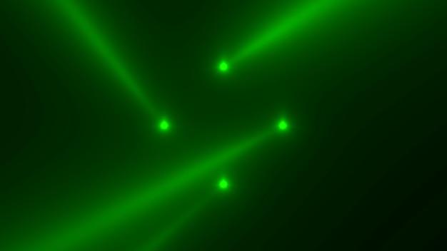 Beweging groene gloeiende schijnwerpers op donkere achtergrond in het podium