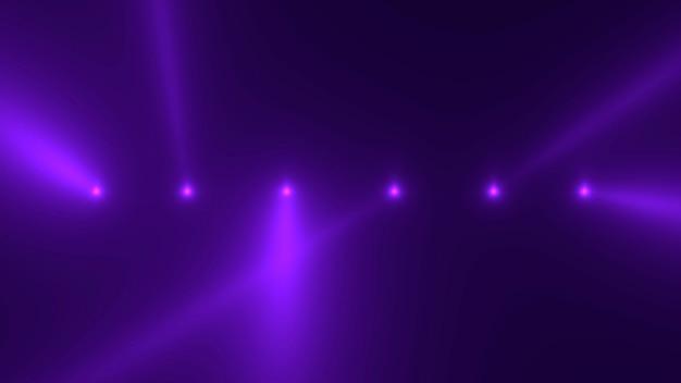 Beweging paarse gloeiende schijnwerpers op donkere achtergrond in het podium