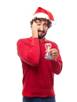 Bezorgd man met kerstmuts en een zandloper