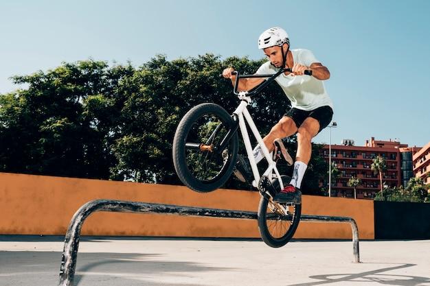 Biker training in skatepark
