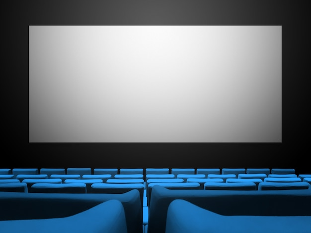 Bioscoop bioscoop met blauwe fluwelen stoelen en een leeg wit scherm. ruimte achtergrond kopiëren