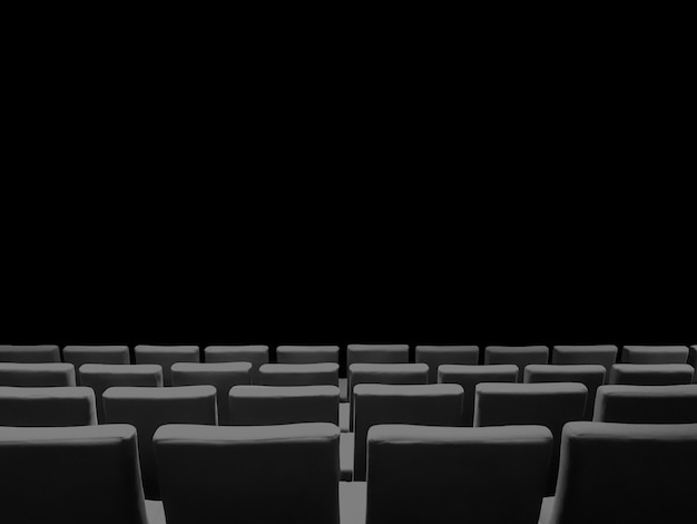 Bioscoop bioscoop met rijen stoelen en een zwarte kopie ruimte achtergrond