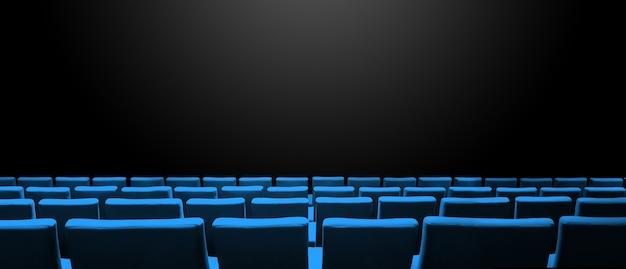Bioscoopbioscoop met blauwe stoelenrijen en een zwarte exemplaarruimteachtergrond. horizontale banner