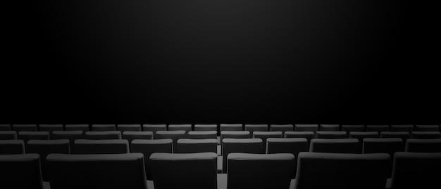 Bioscoopbioscoop met stoelenrijen en een zwarte exemplaarruimteachtergrond. horizontale banner