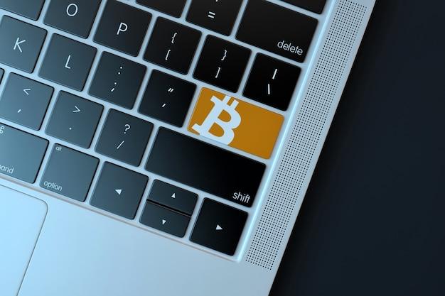 Bitcoin icoon op laptop toetsenbord. technologie concept