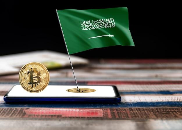Bitcoin saudi-arabië op vlag van saudi-arabië. bitcoin-nieuws en juridische situatie in het concept van saoedi-arabië.