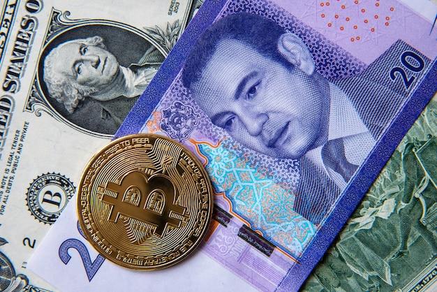 Bitcoin tegen marokkaanse dirham en amerikaanse dollar, close-upbeeld. conceptueel beeld van digitale cryptovaluta tegen traditionele wereldmunt