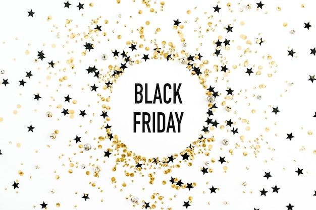 Black friday-verkoopkortingsconcept in rond kader van gouden en zwarte confetti