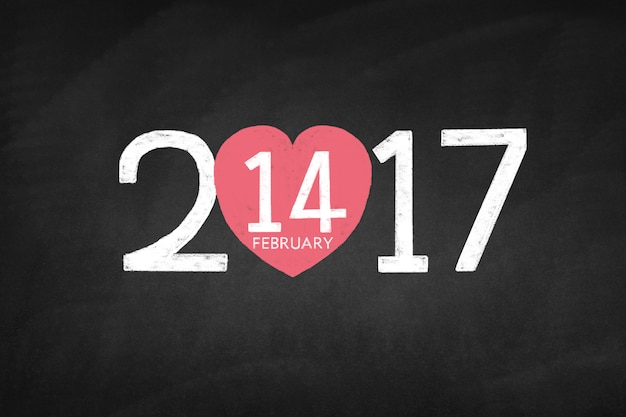 Blackboard met het jaar 2017 en een hart met de 14 van februari
