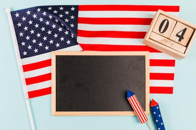 Blackboard met vlag en vuurwerk