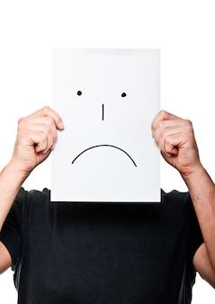 Blanke man met droevig gezicht op papier